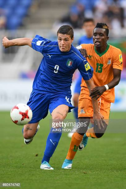 Italy's forward Andrea Favilli and Zambia's defender Shemmy Mayembe compete for the ball during the U20 World Cup quarterfinal football match between...