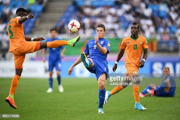 Italy's forward Andrea Favilli and Zambia's defender Solomon Sakala compete for the ball during the U20 World Cup quarterfinal football match between...