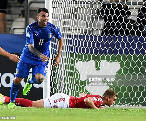 Italy's forward Andrea Petagna reacts after he scored during the UEFA U21 European Championship Group C football match Denmark v Italy in Krakow...