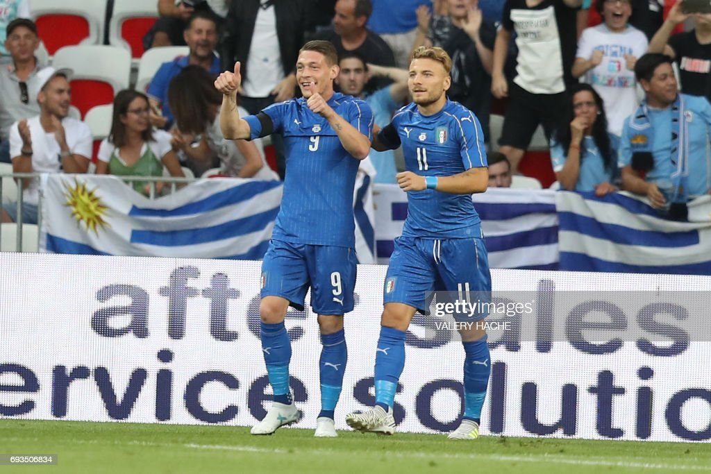 Italy's forward Ciro Immobile (R) and Andrea Belotti celebrates after a goal during a friendly football match Italy vs Uruguay at the Allianz Riviera stadium, in Nice on June 7, 2017. /