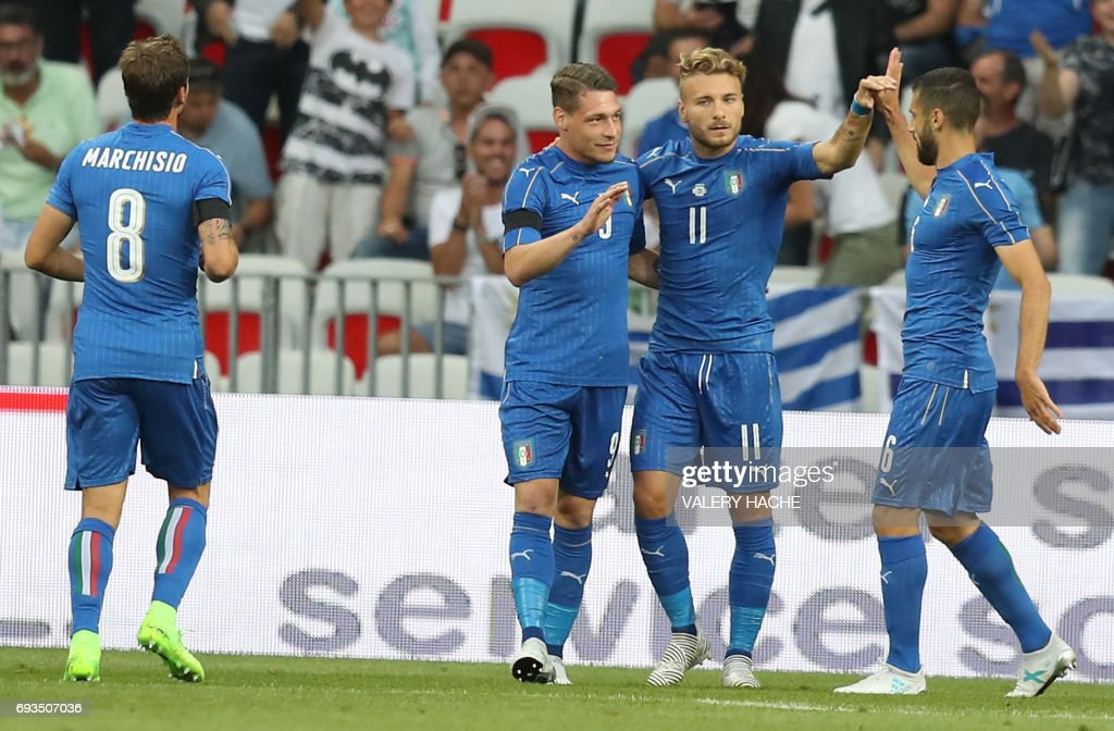 Italy's forward Ciro Immobile (2nd R) and striker Andrea Belotti (2nd L) celebrate after scoring a goal during a friendly football match Italy vs Uruguay at the Allianz Riviera stadium, in Nice on June 7, 2017. /