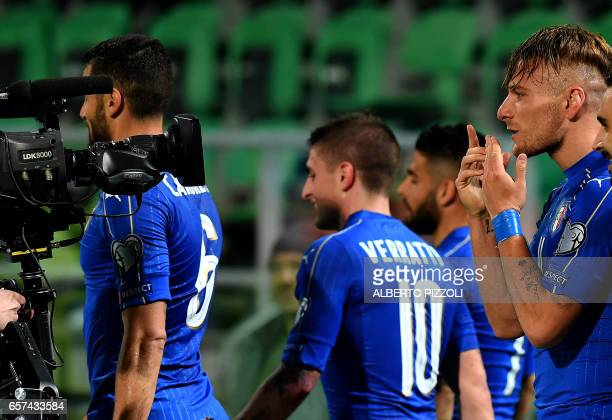 Italy's forward Ciro Immobile celebrates after scoring during the FIFA World Cup 2018 qualification football match between Italy and Albania on March...