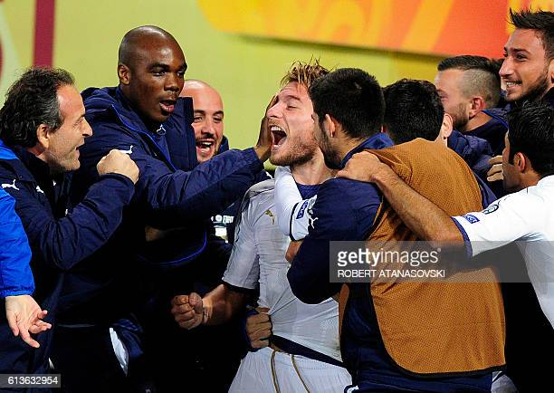 Italy's forward Ciro Immobile celebrates with his teammates after scoring a goal during the FIFA World Cup 2018 qualifying football match between...