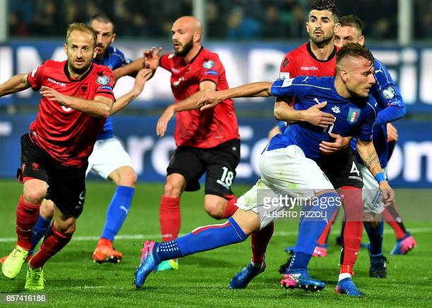 Italy's forward Ciro Immobile escapes from Albania's defender Elseid Hysaj during the FIFA World Cup 2018 qualification football match between Italy...