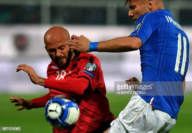 Italy's forward Ciro Immobile fights for the ball with Albania's midfielder Liridon Latifi during the FIFA World Cup 2018 qualification football...