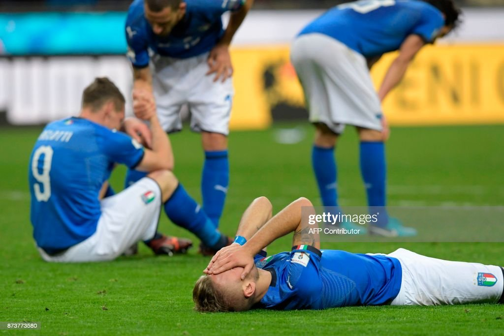 Italy's forward Ciro Immobile react at the end of the FIFA World Cup 2018 qualification football match between Italy and Sweden, on November 13, 2017 at the San Siro stadium in Milan. Italy failed to reach the World Cup for the first time since 1958 on Monday as they were held to a 0-0 draw in the second leg of their play-off at the San Siro by Sweden, who qualified with a 1-0 aggregate victory. / AFP PHOTO / Miguel MEDINA