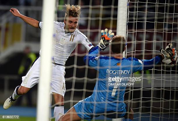 Italy's forward Ciro Immobile scores a goal during the FIFA World Cup 2018 qualifying football match between Macedonia and Italy on October 9 2016 at...