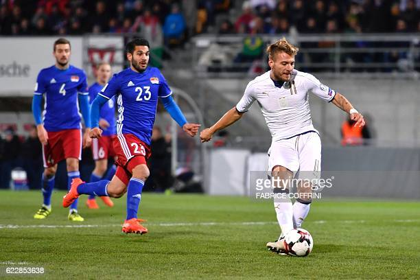Italy's forward Ciro Immobile scores the team's second goal during the FIFA World Cup 2018 European group G Qualifiers football match beetween...