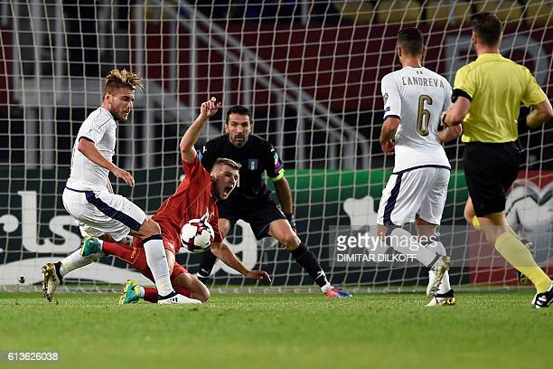 Italy's forward Ciro Immobile vies with Macedonia's defender Stefan Ristovski during the FIFA World Cup 2018 qualifying football match between...