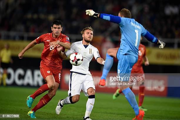 Italy's forward Ciro Immobile vies with Macedonia's defender Vanche Shikov and Macedonia's goalkeeper Martin Bogatinov during the FIFA World Cup 2018...