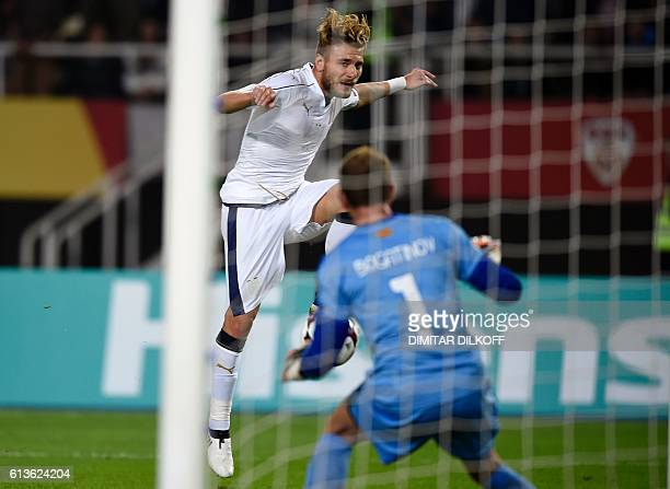 Italy's forward Ciro Immobile vies with Macedonia's goalkeeper Martin Bogatinov during the FIFA World Cup 2018 qualifying football match between...