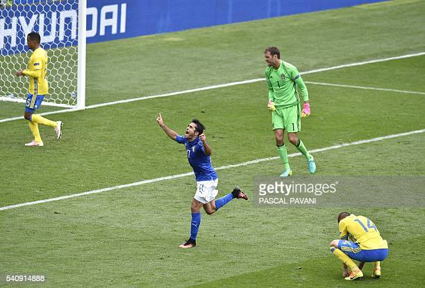 Italy's forward Citadin Martins Eder celebrates a goal during the Euro 2016 group E football match between Italy and Sweden at the Stadium Municipal...