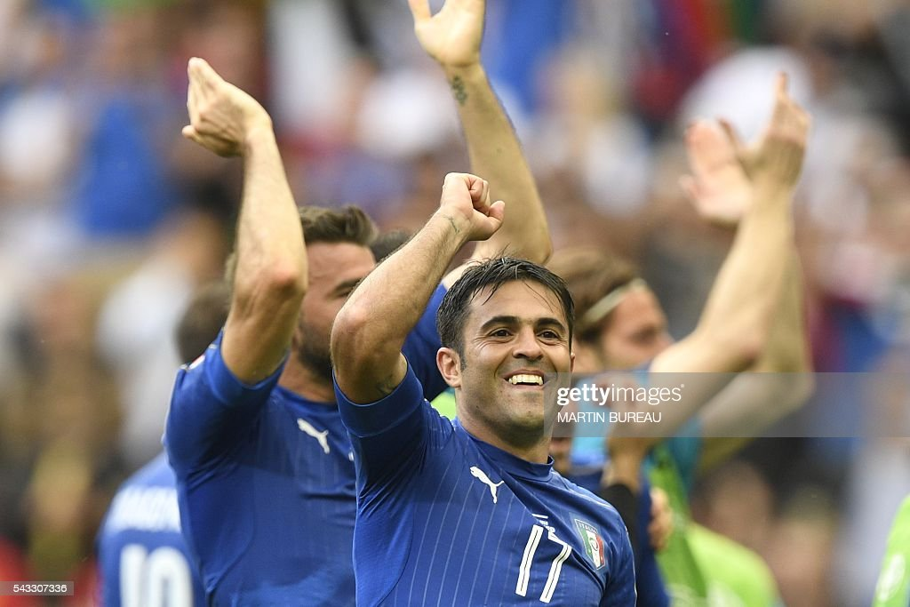 Italy's forward Citadin Martins Eder celebrates following their 2-0 win over Spain in the Euro 2016 round of 16 football match between Italy and Spain at the Stade de France stadium in Saint-Denis, near Paris, on June 27, 2016. / AFP / MARTIN