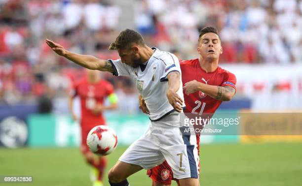 Italy's forward Domenico Berardi and Czech Republic's defender Daniel Holzer vie for the ball during the UEFA U21 European Championship Group C...