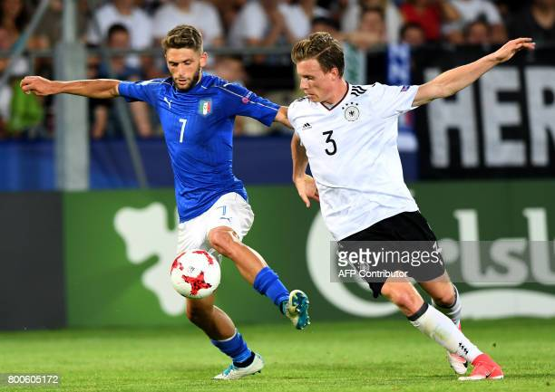 Italy's forward Domenico Berardi and Germany's defender Yannick Gerhardt vie for the ball during the UEFA U21 European Championship Group C football...