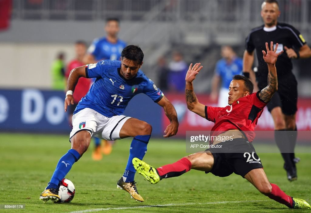 Italy's forward Eder (L) vies with Albania's midfielder Ergys Kace during the FIFA World Cup 2018 qualification football match between Albania and Italy at Loro Borici Stadium in Shkoder on October 9, 2017. / AFP PHOTO / Dimitar DILKOFF