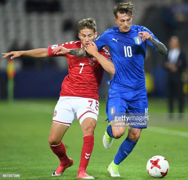 Italy's forward Federico Bernardeschi and Denmark's midfielder Andrew Hjulsager vie for the ball during the UEFA U21 European Championship Group C...
