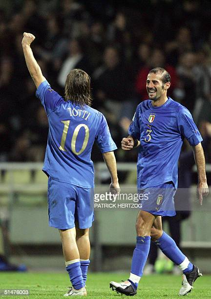 Italy's forward Francesco Totti celebrates the third goal against Belarus as teammate Giuseppe Pancaro looks on during their World Cup 2006...