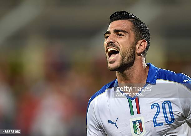 Italy's forward Graziano Pelle celebrates after scoring a goal during the Euro 2016 group H qualifying football match between Italy and Malta on...