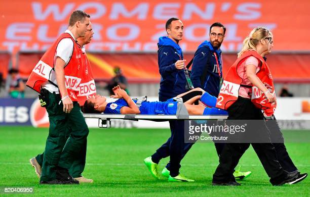 Italy's forward Ilaria Mauro is taken away on a stretcher during the UEFA Women's Euro 2017 football tournament between Germany and Italy at Stadium...
