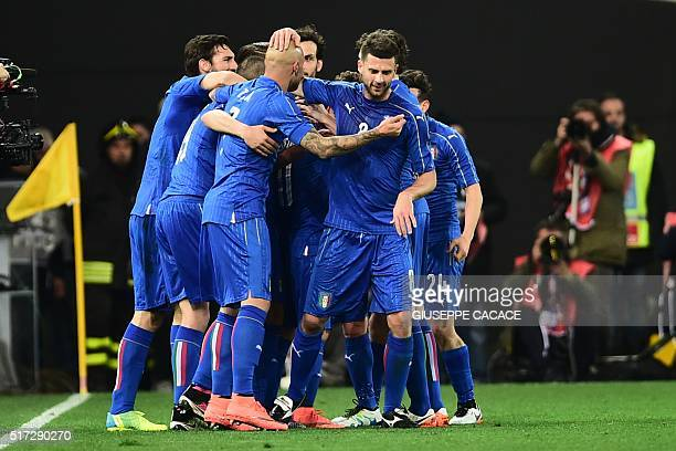 Italy's forward Lorenzo Insigne celebrates with teammates after scoring during the friendly football match between Italy and Spain at 'FriuliDacia...