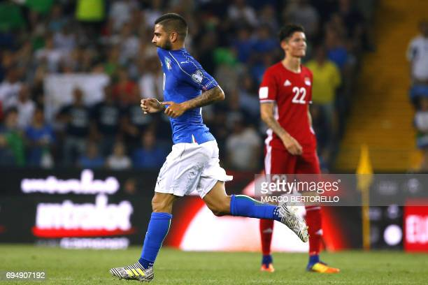 Italy's forward Lorenzo Insigne is watched by Liechtenstein's Yanik Frick as he celebrates after scoring during the FIFA WC 2018 football...