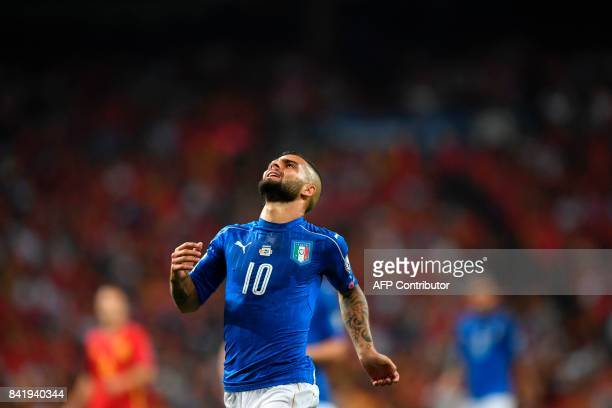Italy's forward Lorenzo Insigne reacts during the World Cup 2018 qualifier football match Spain vs Italy at the Santiago Bernabeu stadium in Madrid...