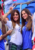 Italy's forward Lorenzo Insigne's wife Jenny Darone and Italy's forward Ciro Immobile's girlfriend gesture prior to the Group D football match...