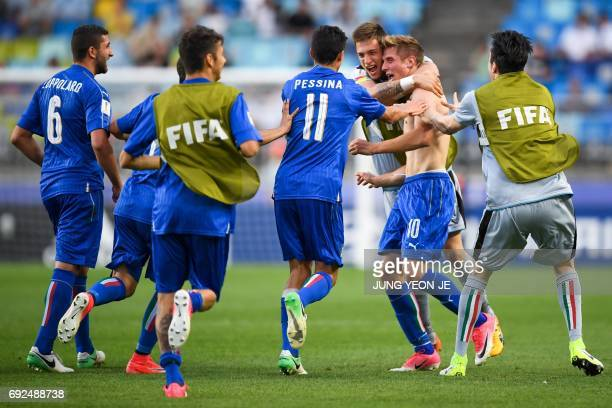 Italy's forward Luca Vido celebrates his goal with teammates during the U20 World Cup quarterfinal football match between Italy and Zambia in Suwon...