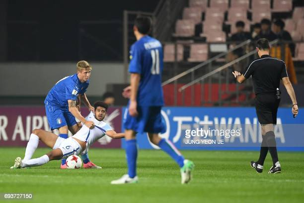 Italy's forward Luca Vido picks up England's defender Jake ClarkeSalter before receiving a yellow card from the referee during the U20 World Cup...