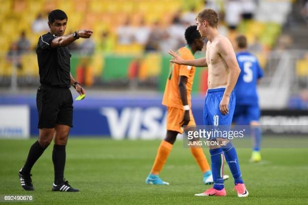 Italy's forward Luca Vido receives a yellow card after celebrating his goal during the U20 World Cup quarterfinal football match between Italy and...