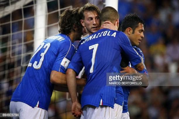 Italy's forward Manolo Gabbiadini celebrates with his teammates after scoring a goal during the FIFA World Cup 2018 qualification football match...