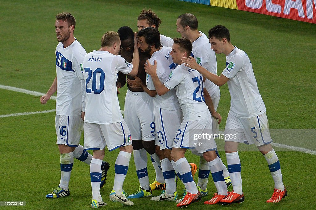 Italy's forward Mario Balotelli (shirtless) celebrates with teammates after scoring against Mexico during their FIFA Confederations Cup Brazil 2013 Group A football match, at the Maracana Stadium in Rio de Janeiro on June 16, 2013.