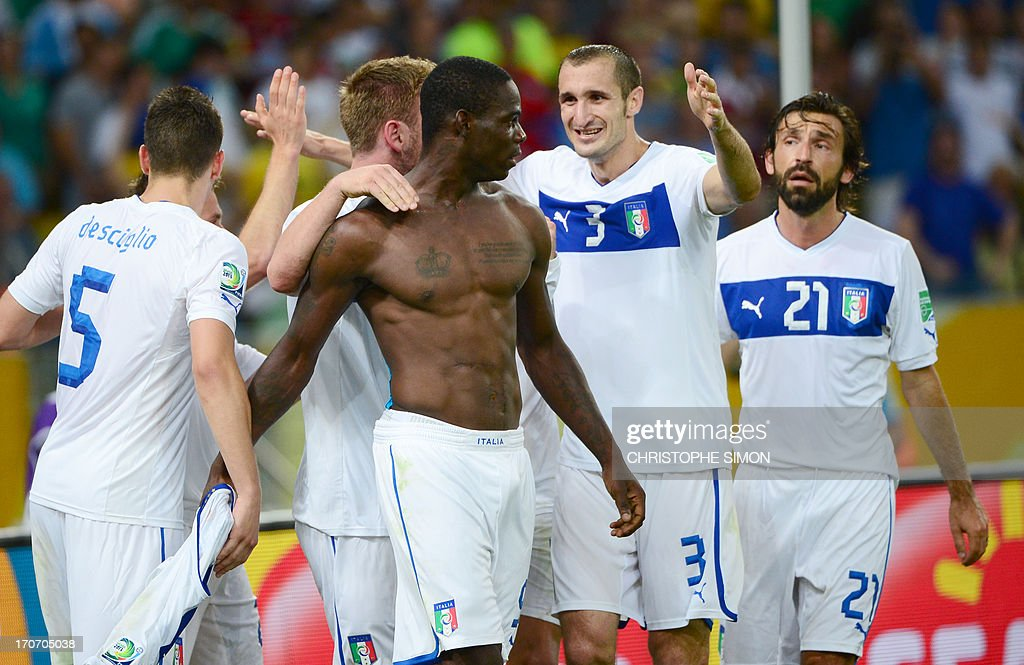 Italy's forward Mario Balotelli (shirtless) celebrates with teammates after scoring against Mexico during their FIFA Confederations Cup Brazil 2013 Group A football match, at the Maracana Stadium in Rio de Janeiro on June 16, 2013. AFP PHOTO / CHRISTOPHE SIMON