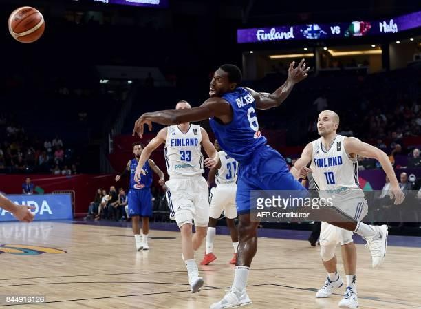 Italy's forward Paul Biligha vies for the ball with Finland's Erik Murphy and center Tuukka Kotti during their FIBA Eurobasket 2017 men's round 16...