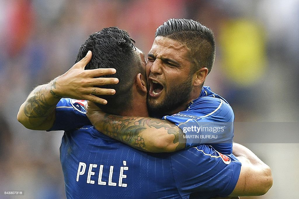 Italy's forward Pelle celebrates with Italy's forward Lorenzo Insigne following their 2-0 win over Spain in the Euro 2016 round of 16 football match between Italy and Spain at the Stade de France stadium in Saint-Denis, near Paris, on June 27, 2016. / AFP / MARTIN