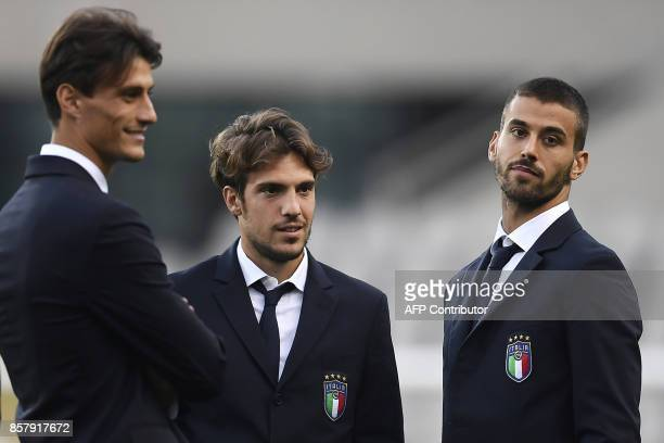 Italy's forward Roberto Inglese Italy's midfielder Simone Verdi and Italy's midfielder Leonardo Spinazzola walk around the 'Grande Torino Stadium' on...