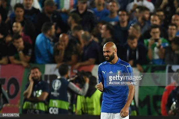 Italy's forward Simone Zaza reacts after missing a penalty during a penalty shootout of the Euro 2016 quarterfinal football match between Germany and...