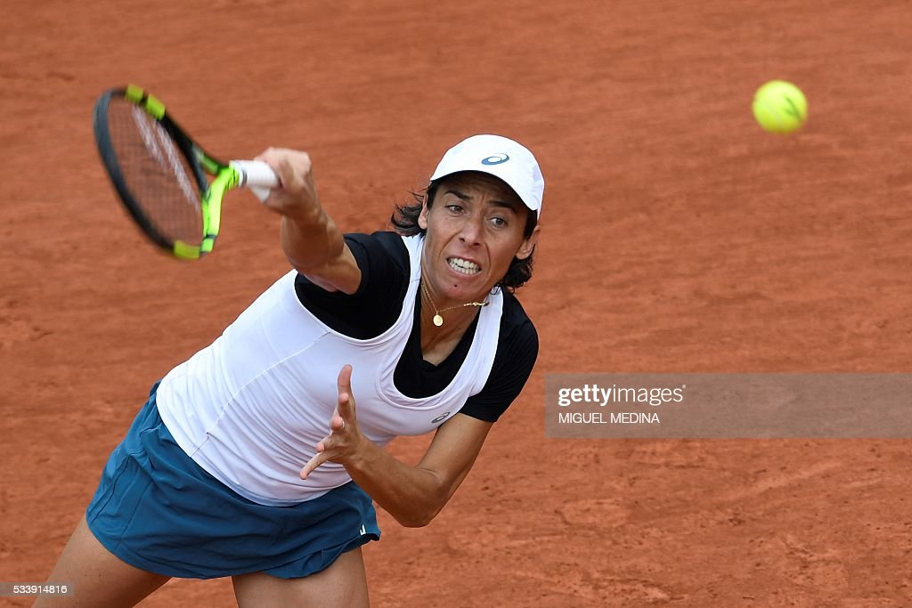 Italy's Francesca Schiavone serves the ball to France's Kristina Mladenovic during their women's first round match at the Roland Garros 2016 French Tennis Open in Paris on May 24, 2016. / AFP / MIGUEL