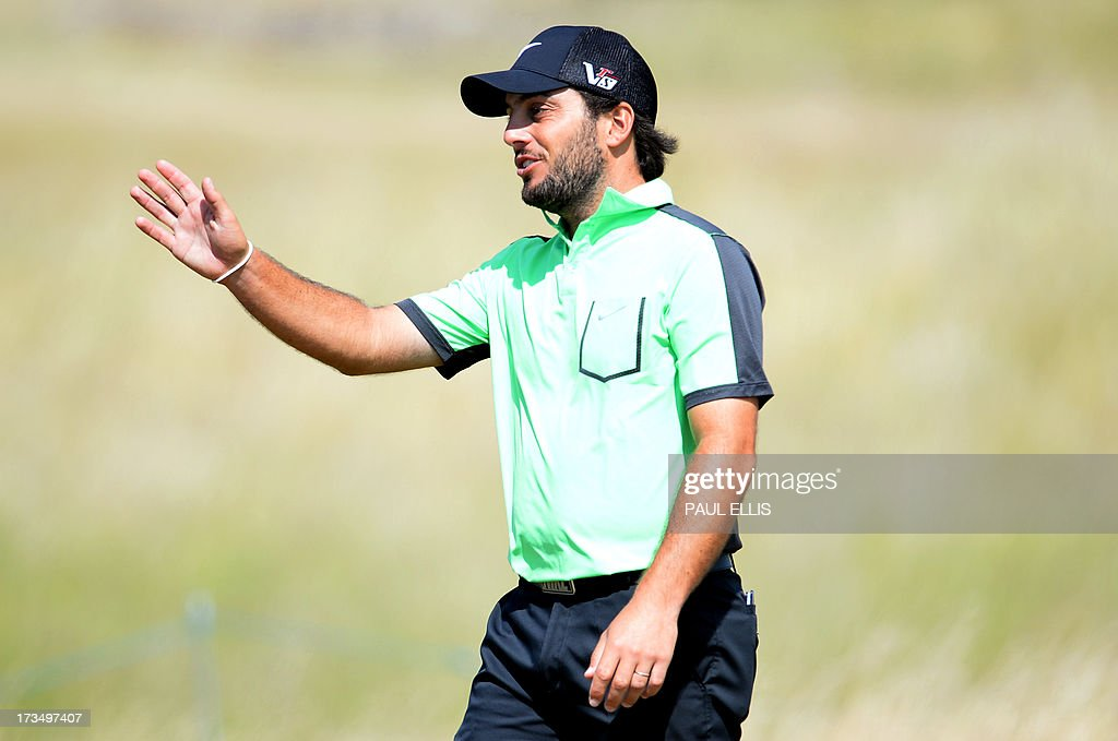 Italy's Francesco Molinari walks to the seventh green at Muirfield golf course at Gullane in Scotland on July 15, 2013 ahead of The 2013 Open Golf Championship. AFP PHOTO/Paul Ellis