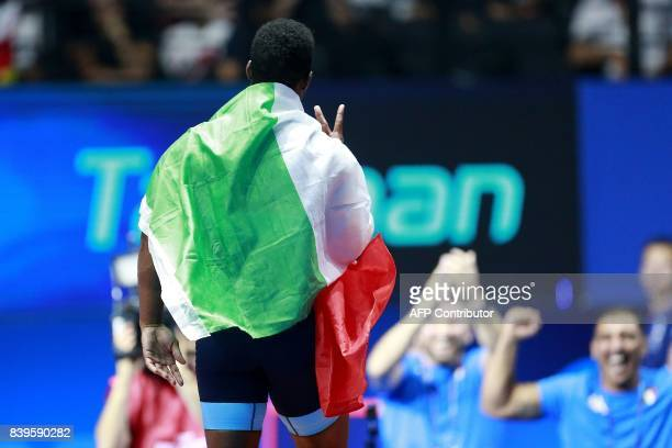 Italy's Frank Chamizo celebrates after winning the men's freestyle wrestling 70kg category final at the FILA World Wrestling Championships in Paris...
