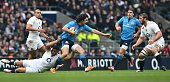 Italy's full back Luke McLean is tackled by England's centre Luther Burrell during the Six Nations international rugby union match between England...