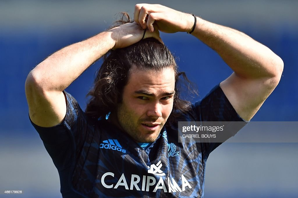 Italy's fullback <a gi-track='captionPersonalityLinkClicked' href=/galleries/search?phrase=Luke+McLean&family=editorial&specificpeople=5700811 ng-click='$event.stopPropagation()'>Luke McLean</a> gets ready for the captain's run of his team, on March 14, 2015, at the Olympic Stadium in Rome, on the eve of the Six Nations International Rugby Union match between Italy and France.