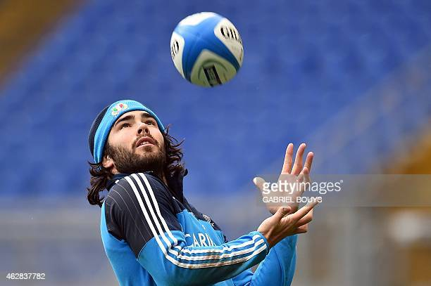 Italy's fullback Luke McLean grabs the ball during the captain's run of his team on February 6 2015 at the Olympic Stadium in Rome on the eve of the...