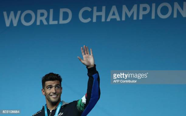 Italy's Gabriele Detti celebrates winning the gold medal during the podium ceremony for the men's 800m freestyle final during the swimming...