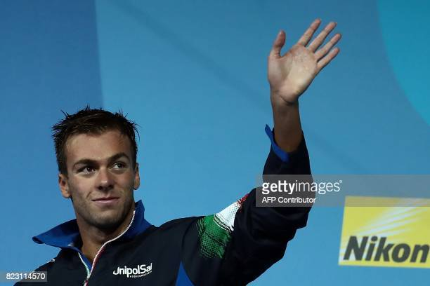 Italy's Gabriele Detti gestures during the podium ceremony for the men's 800m freestyle final during the swimming competition at the 2017 FINA World...