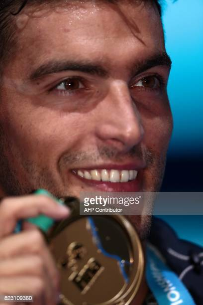 Italy's Gabriele Detti poses with the gold medal during the podium ceremony for the men's 800m freestyle final during the swimming competition at the...