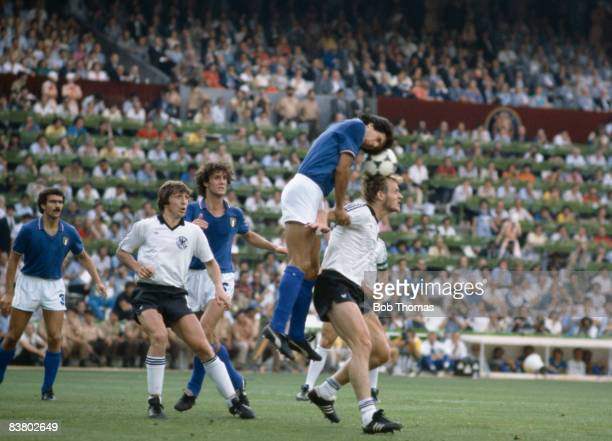 Italy's Gaetano Scirea climbs above West Germany's Hans Peter Briegel watched by Klaus Fischer and Fulvio Collovati during the World Cup Final at the...