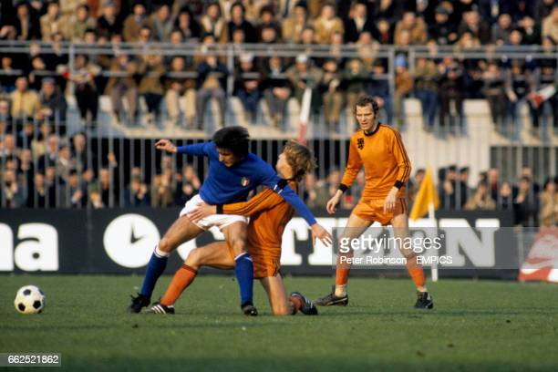 Italy's Gaetano Scirea holds off Holland's Johnny Rep watched by Holland's Willy Van De Kerkhof
