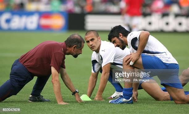 Italy's Gennaro Gattuso and Fabio Cannavaro warm up before the match